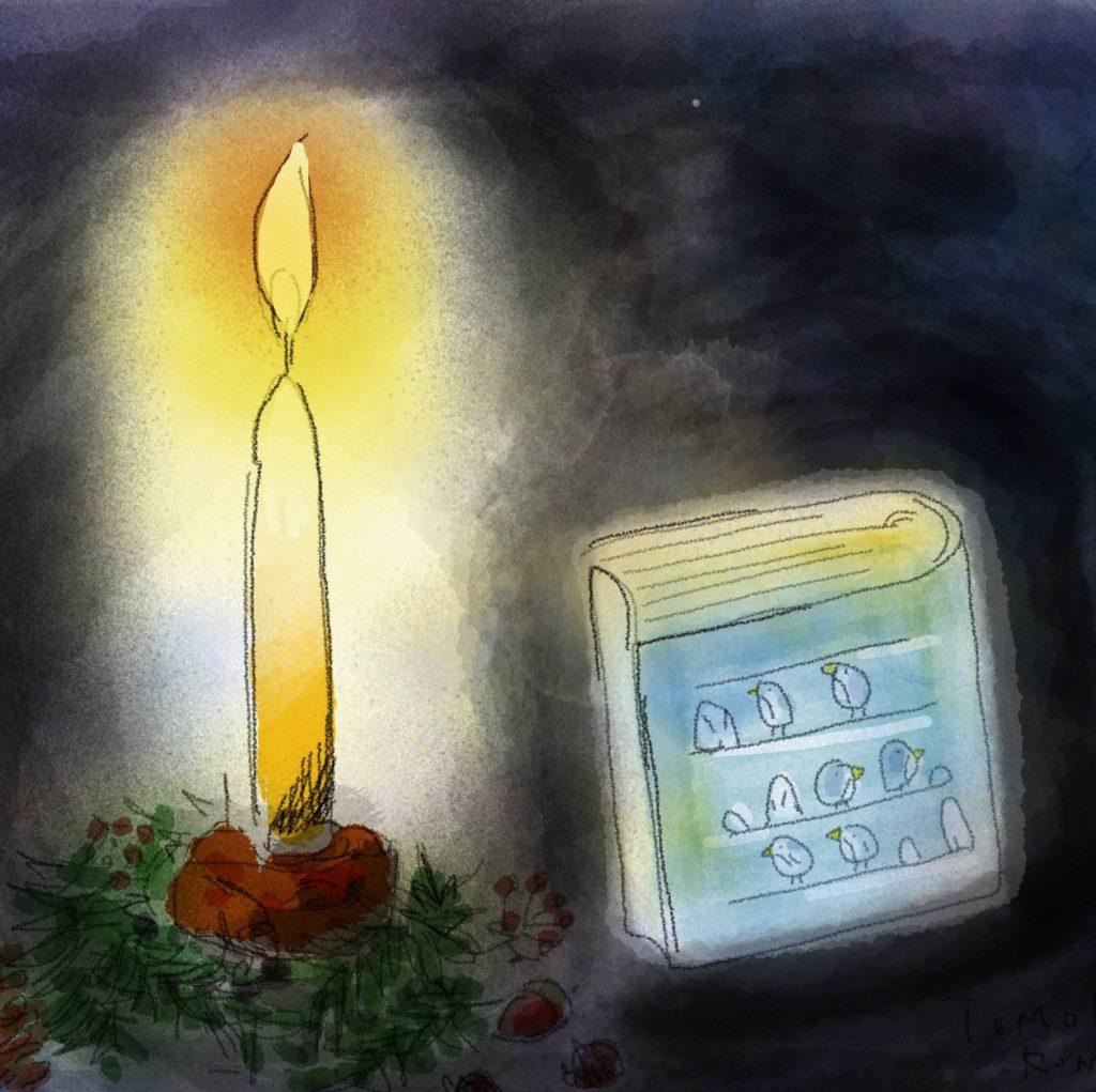 ロウソクと聖書の画像